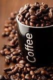 Coffee beans and a coffee mug Royalty Free Stock Photos