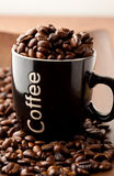 Coffee beans and a coffee mug Stock Photo