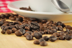 Coffee beans and coffee mug Royalty Free Stock Photography