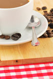 Coffee beans and coffee mug Stock Images