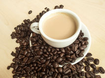 Coffee beans and coffee mug Royalty Free Stock Photos