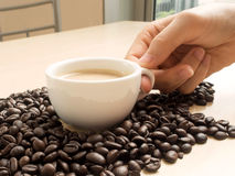 Coffee beans and coffee mug Royalty Free Stock Image