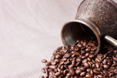 Coffee beans with coffee pot Royalty Free Stock Image