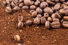 Coffee beans with coffee powder Stock Images