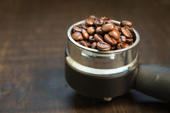 Coffee beans in the coffee tablet. Stil life style. Stock Photo