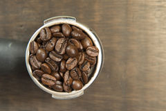 Coffee beans in the coffee tablet. Stil life style. Royalty Free Stock Photo