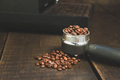 Coffee beans in the coffee tablet. Stil life style and Vintage. Stock Photos