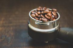 Coffee beans in the coffee tablet. Stil life style and Vintage. Stock Image