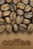 Coffee beans and  coffee  text. Coffee beans and \ coffee \ text on brown background Royalty Free Stock Photography