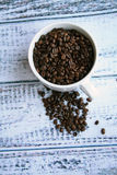 Coffee beans coffee in white mug wooden background Stock Photos