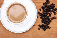 Coffee beans with coffee Stock Images