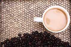 Coffee beans with coffee. Royalty Free Stock Photography