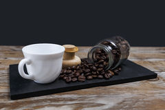Coffee beans coming out of the jar Royalty Free Stock Photo