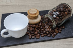 Coffee beans coming out of the jar Royalty Free Stock Image
