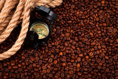 Coffee beans with compass. And cordage, concept Stock Photography
