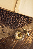 Coffee beans and compass Royalty Free Stock Photography