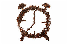 Coffee beans conventionalized to clock. Coffee beans in shape of alarm clock Stock Photography