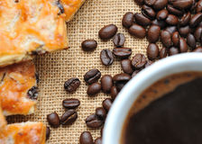 Coffee beans with cookies and cup of coffee Stock Photo