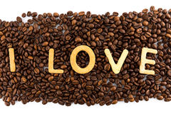Coffee beans with cookies in shape of Love word Stock Photography