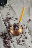 Coffee beans and copper coffee maker Royalty Free Stock Image