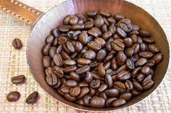 Coffee beans in a copper pan Royalty Free Stock Image