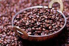 Coffee beans in a copper plate Royalty Free Stock Images