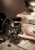 Coffee beans, copper pot and grinder on sack Stock Photos