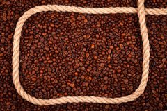 Coffee beans with cordage. As a frame, concept Royalty Free Stock Images