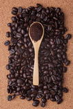 Coffee beans on cork background top view Stock Photos
