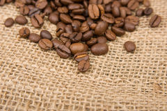 Coffee beans on cotton Royalty Free Stock Images
