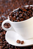 Coffee beans in a cup Royalty Free Stock Image