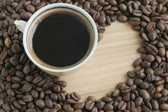 Coffee beans and cup. Roasted coffee beans and cup Royalty Free Stock Image
