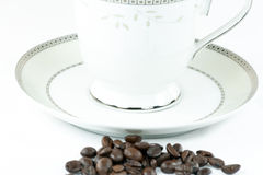 Coffee beans and cup. Stock Photo