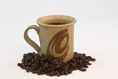 Coffee, beans and cup Royalty Free Stock Photo