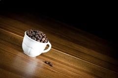 Coffee beans in cup Royalty Free Stock Photo