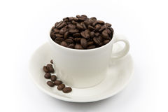 Coffee beans in a cup Stock Photos