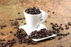 Coffee beans in a cup Royalty Free Stock Images