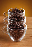 Coffee beans in the cup Stock Images