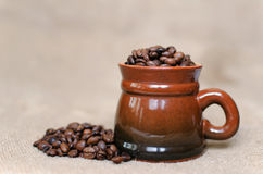 Cup of coffee. Coffee beans in a cup Stock Photos