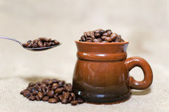 Cup of coffee. Coffee beans in a cup Royalty Free Stock Photography