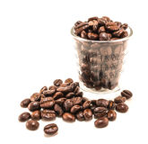 Coffee beans in cup. Arabica coffee beans in a clear cup with measure Royalty Free Stock Photos
