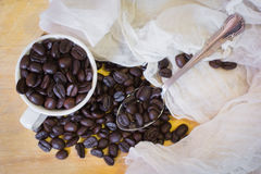 Coffee beans and Cup. Cup of coffee with beans on black background Royalty Free Stock Photos