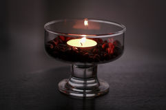 Coffee beans in a cup with a candle Stock Images