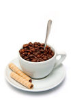 Coffee beans in a cup and candy Royalty Free Stock Images
