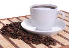 Coffee beans and cup of coffee Royalty Free Stock Photography