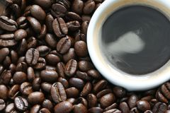 Coffee beans with cup of coffee Royalty Free Stock Photos