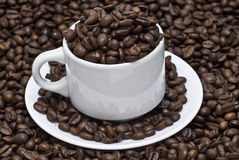 Coffee beans in a cup of coffee. Stock Photography