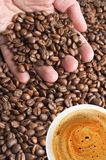 Coffee beans and cup of coffee. Palm with coffee beans and cup of coffee Stock Photos