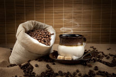 Coffee beans and cup with coffee Stock Images