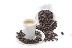 Coffee beans with cup of coffee Stock Photos